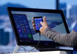 Joe Belfiore, Microsoft Corporate Vice President of Operating Systems Group, demonstrates Continuum for phones at the Microsoft Build conference in San Francisco, Wednesday, April 29, 2015. While Microsoft has already previewed some aspects of the new Windows 10, a parade of top executives will use the conference to demonstrate more software features and app-building tools, with an emphasis on mobile devices as well as PCs. (AP Photo/Jeff Chiu)