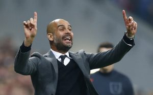 FILE - In this April 21, 2015 file picture Bayern's head coach Pep Guardiola instructs his players during the soccer Champions League quarterfinal second leg match between Bayern Munich and FC Porto at the Allianz Arena in Munich, southern Germany. Bayern Munich says  Sunday Dec. 20, 2015 coach Pep Guardiola will leave the club at the end of the season and will be replaced by Carlo Ancelotti. Ancelotti, winner of three Champions League titles, signed a three-year deal. Despite the club's willingness for him to stay on, Guardiola decided to leave after three seasons in charge.  (AP Photo/Matthias Schrader,file)