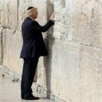 epa05981594 U.S. President Donald Trump touches the Western Wall, Judaism's holiest prayer site, in Jerusalem's Old City, 22 May 2017. Trump arrived for a 28-hour visit to Israel and the Palestinian Authority areas on his first foreign trip since taking office in January.  EPA/RONEN ZVULUN / POOL