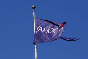 FILE PHOTO: A tattered flag bearing the Yahoo company logo flies above a building in New York, U.S., October 31, 2016. REUTERS/Lucas Jackson